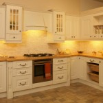kitchen-trendy-wooden-white-free-standing-kitchen-cabinets-plus-drawers-as-storage-with-modern-kitchen-stove-natural-panels-flooring-installations-white-walls-color-in-cool-small-kitchen-design-unusu-930x554
